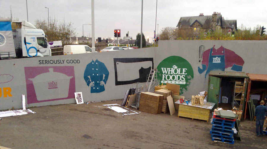 Partially completed large scale mural for Whole foods Market loading bay, Giffnock, Glasgow